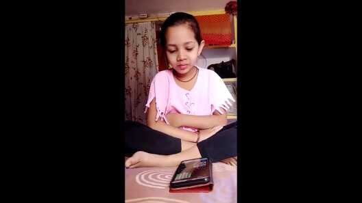 A child engaged in an interactive video on English letters and their sounds